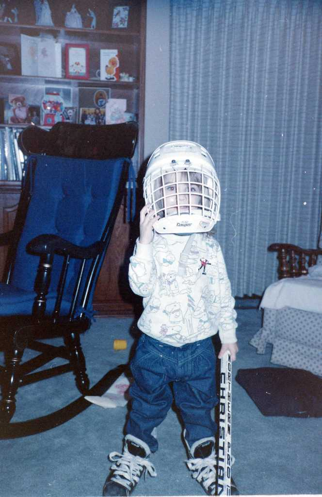 Trying on all of my brother's hockey gear.