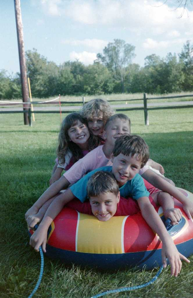 Later that week, the cousins pile up on a water tube.