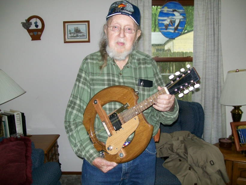 This is a friend of my Grandpa's named Jack B. He loved to collect instruments. Here he is posing with some kind of guitar, but what I really idolized him for was his HARP collection. He had like 6 harps! When I first got into playing the harp, I remember going over to his house and messing around with his instruments. I was in awe of him.
